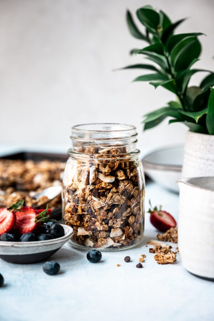 side view of banana bread granola in a jar
