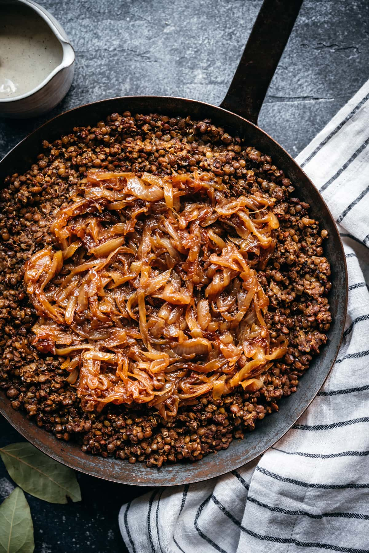 overhead view of mujadara in a pan with caramelized onions