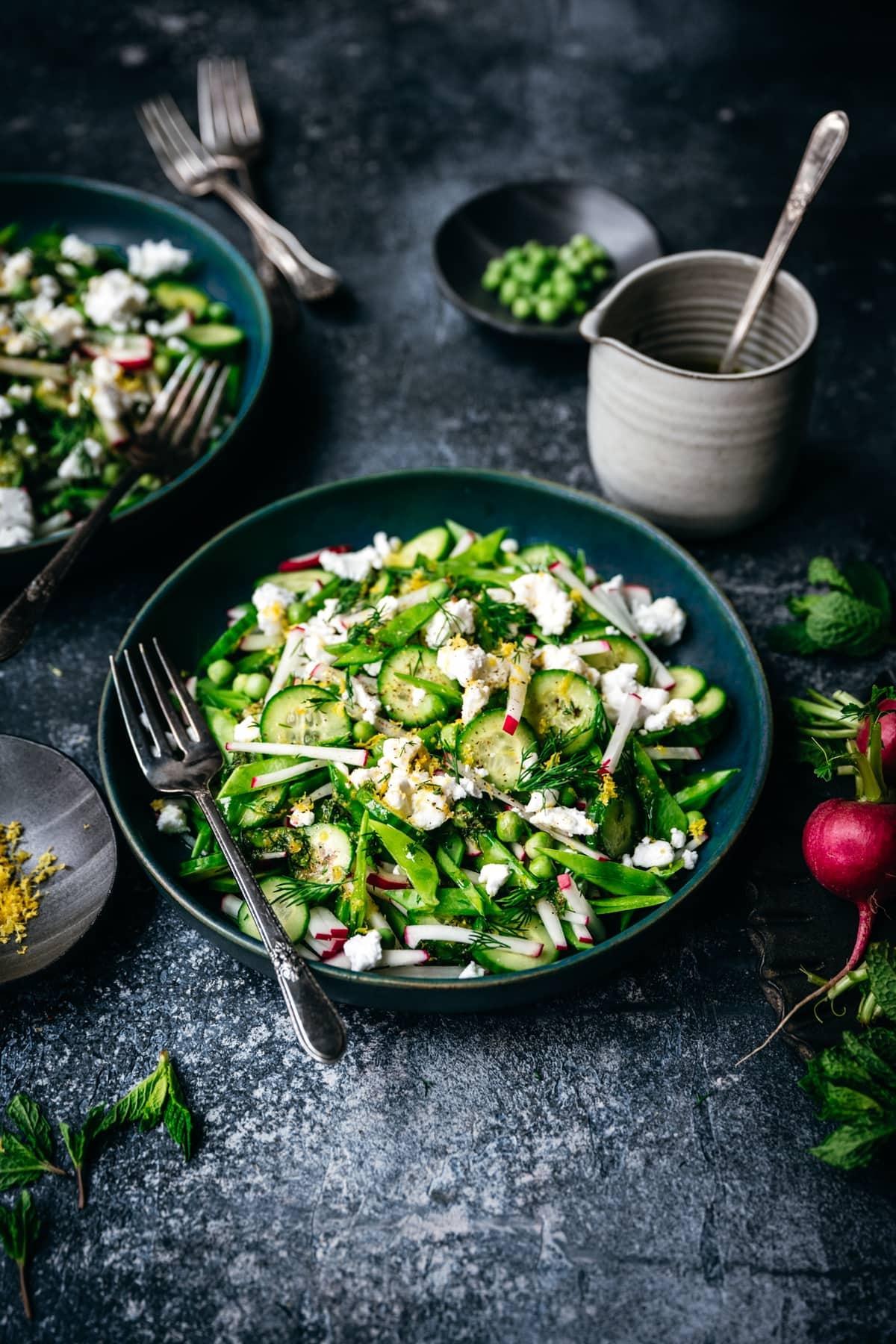 side view of fresh snow pea and radish salad with lemon herb vinaigrette
