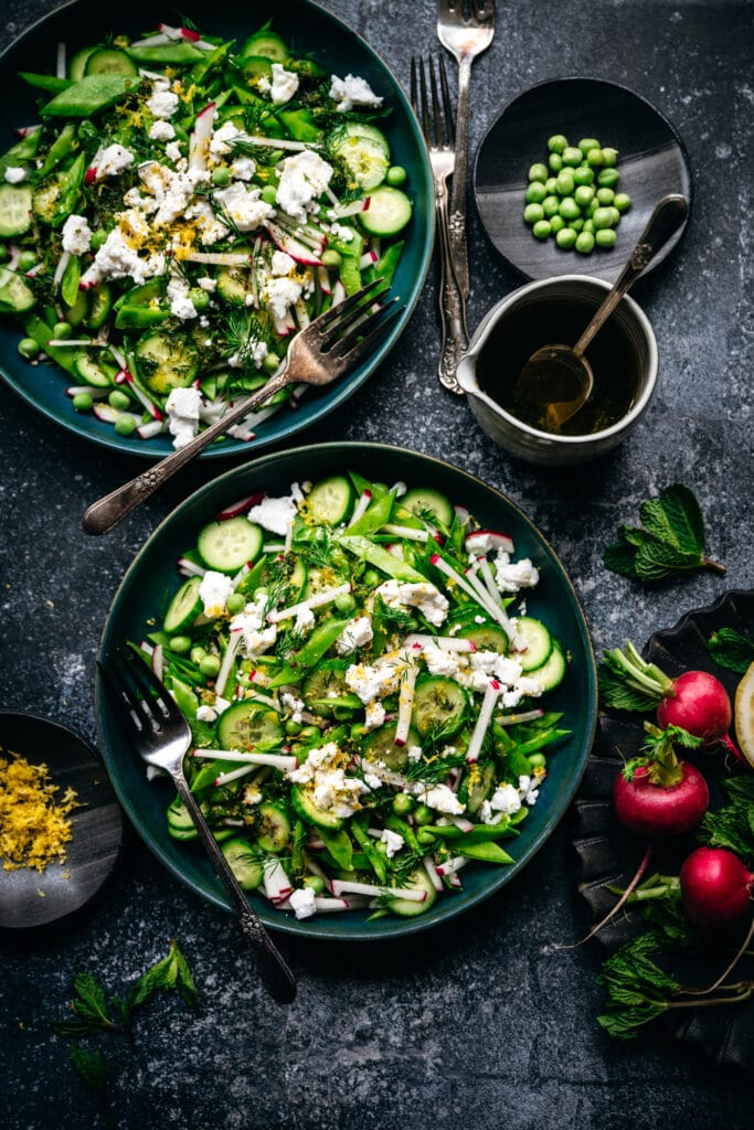 overhead view of two bowls of snow pea salad with radishes