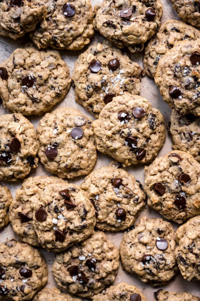 overhead view of gluten free vegan oatmeal raisin cookies on sheet pan