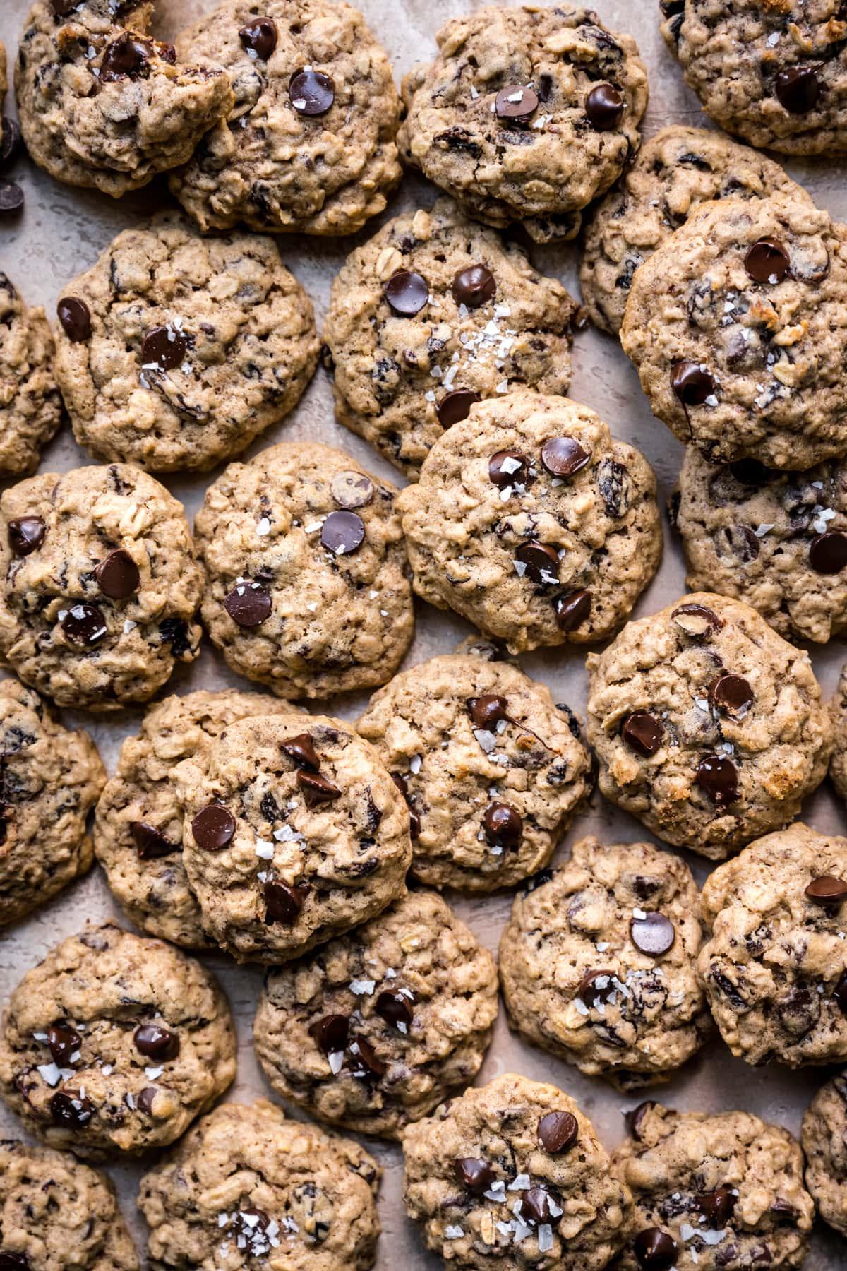 overhead view of gluten free vegan oatmeal raisin chocolate chip  cookies on sheet pan