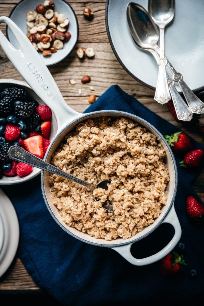 overhead view of vegan breakfast quinoa in pot