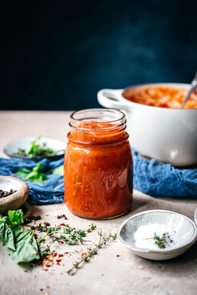side view of homemade tomato sauce in a jar