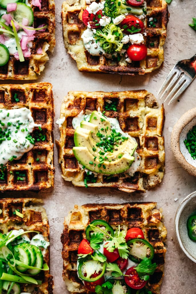 overhead view of mashed potato waffles with savory toppings