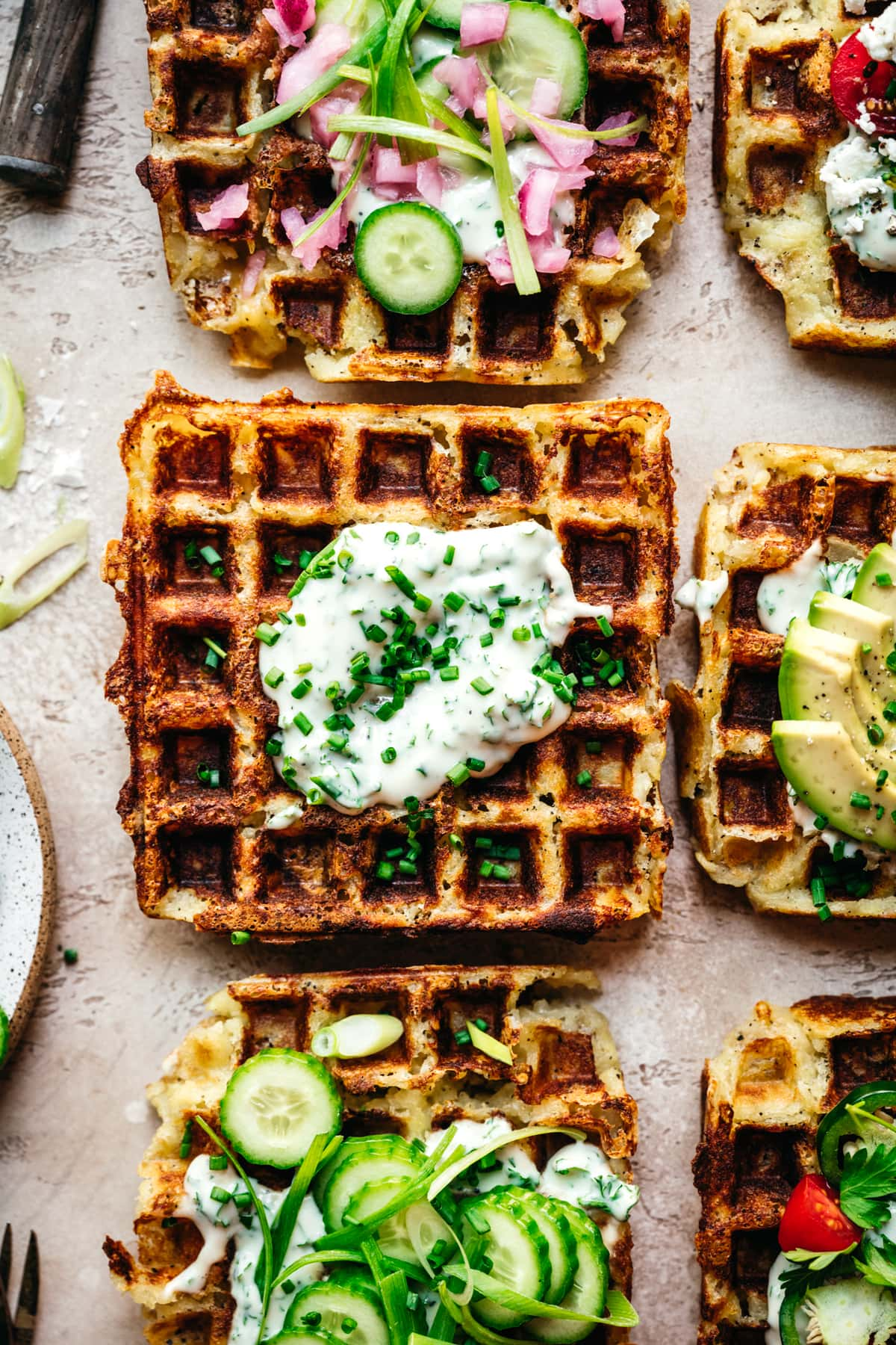 overhead view of savory mashed potato waffle with herb yogurt sauce