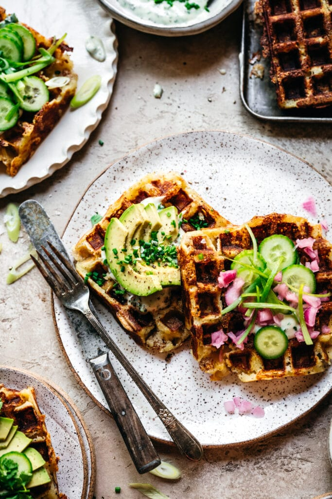 overhead view of savory mashed potato waffles on a plate