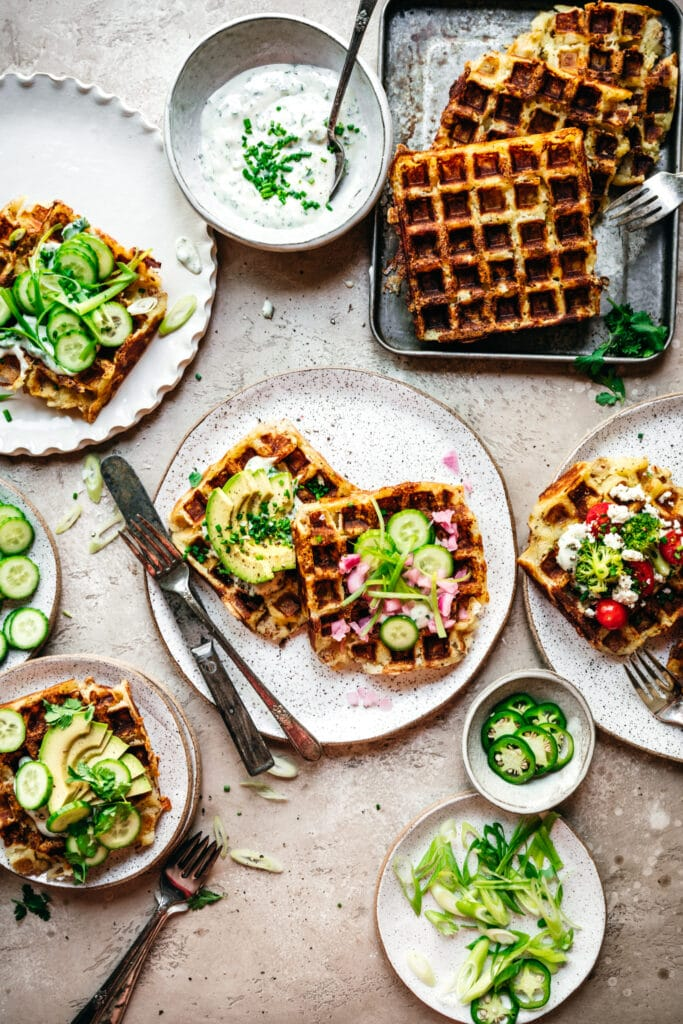overhead view of savory mashed potato waffles with toppings