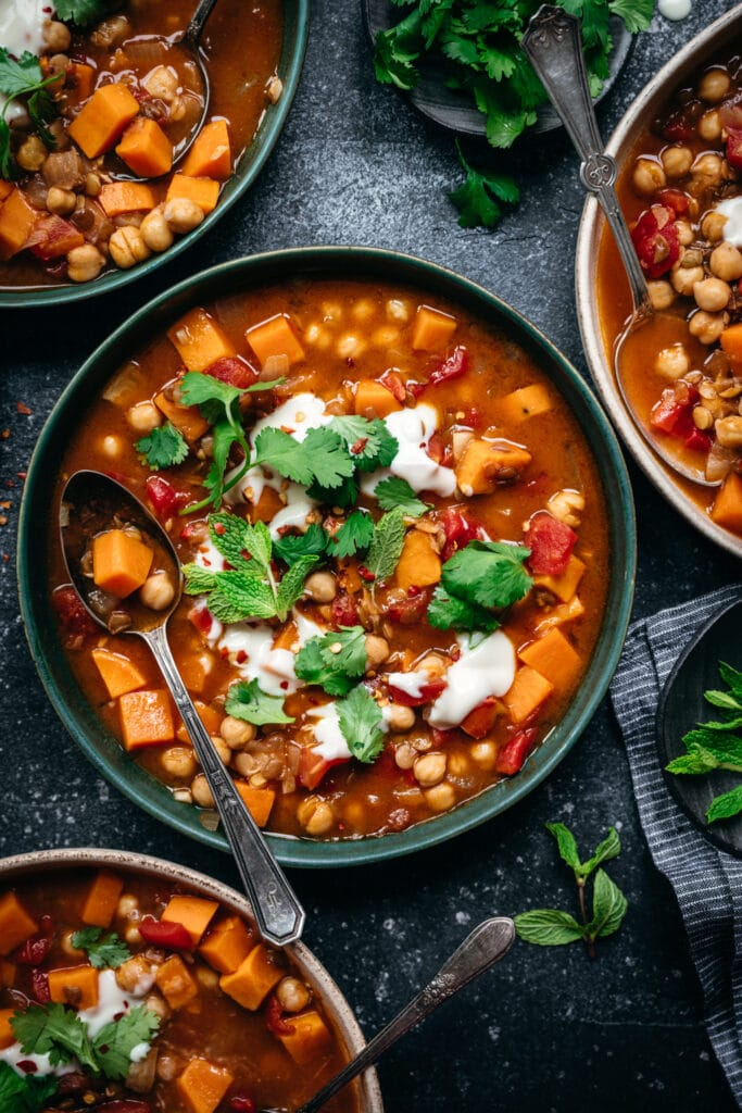 overhead view of vegan Moroccan chickpea lentil stew in bowl
