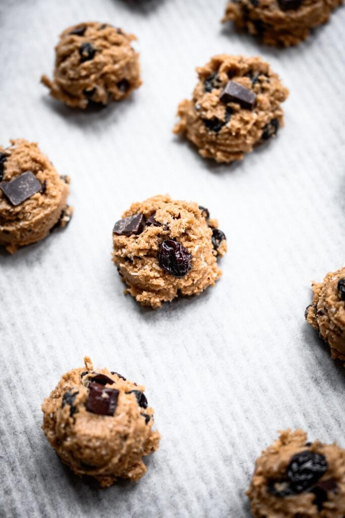 oatmeal dark chocolate cherry cookie dough on baking sheet