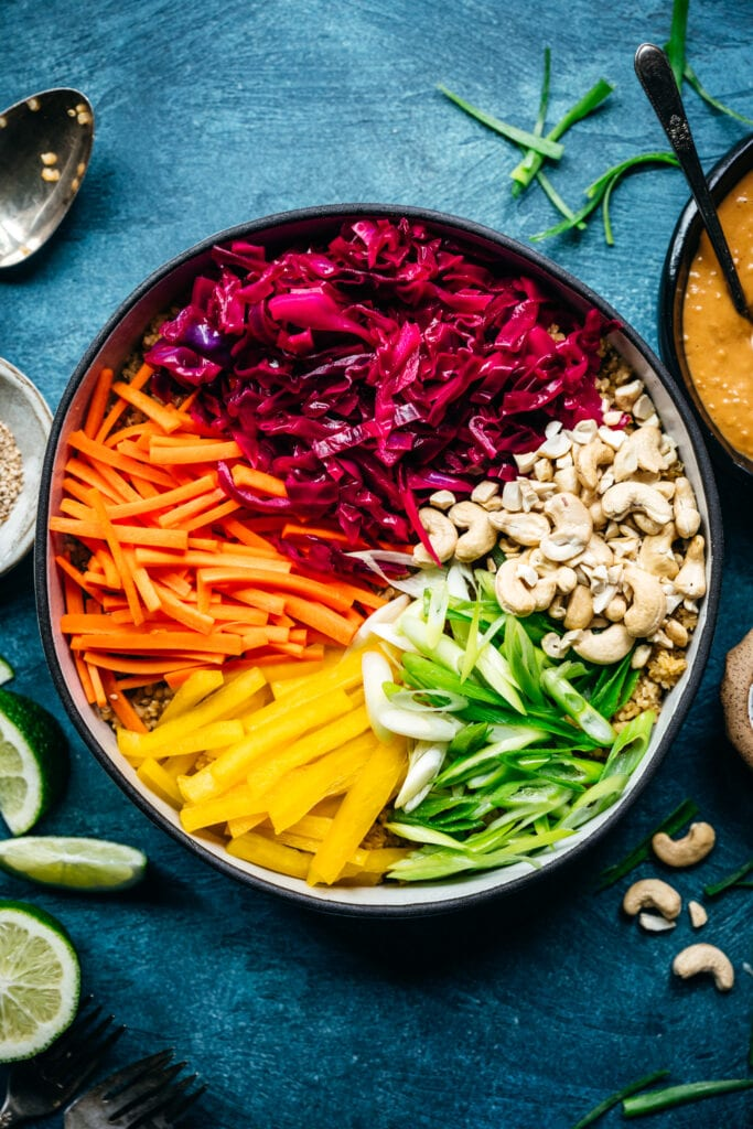 overhead view of ingredients for vegan thai quinoa salad with rainbow vegetables