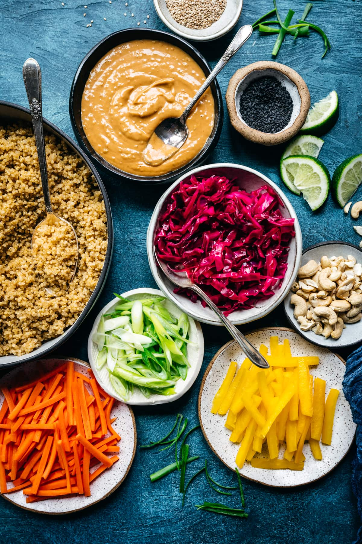 overhead view of colorful vegetable ingredients for thai quinoa peanut salad