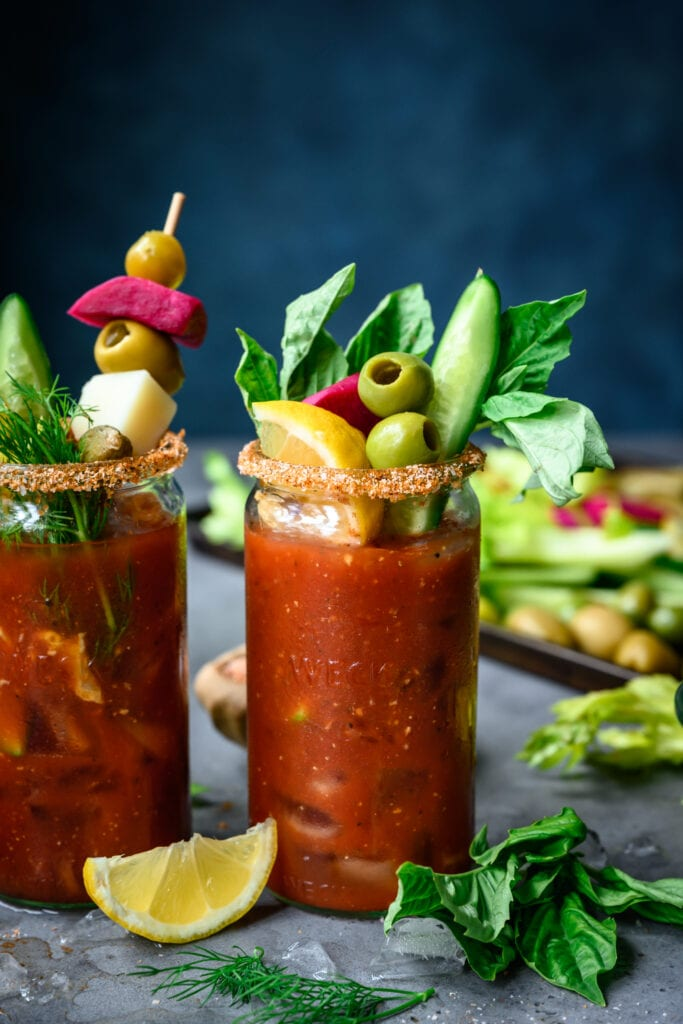 side view of vegan bloody mary with toppings