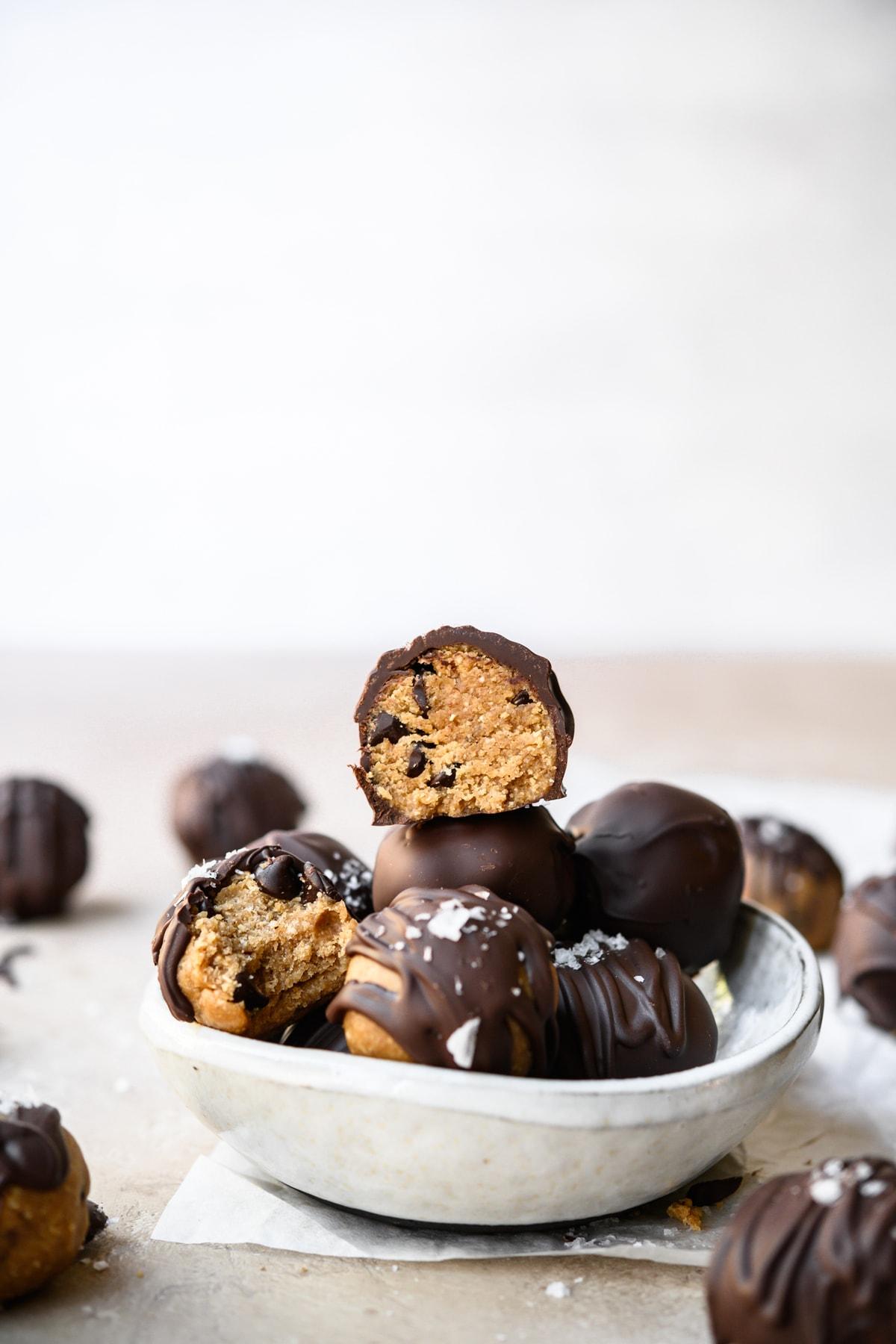 side view of bowl full of vegan gluten free cookie dough truffles