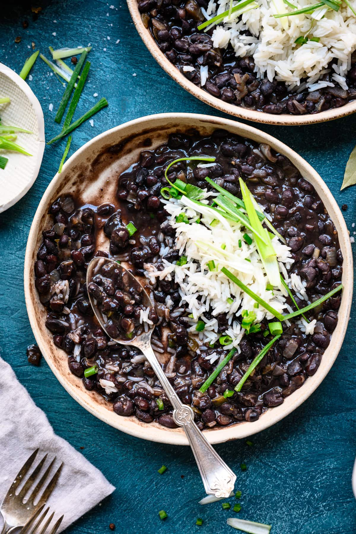 close up overhead of vegetarian cuban black beans in bowl with rice