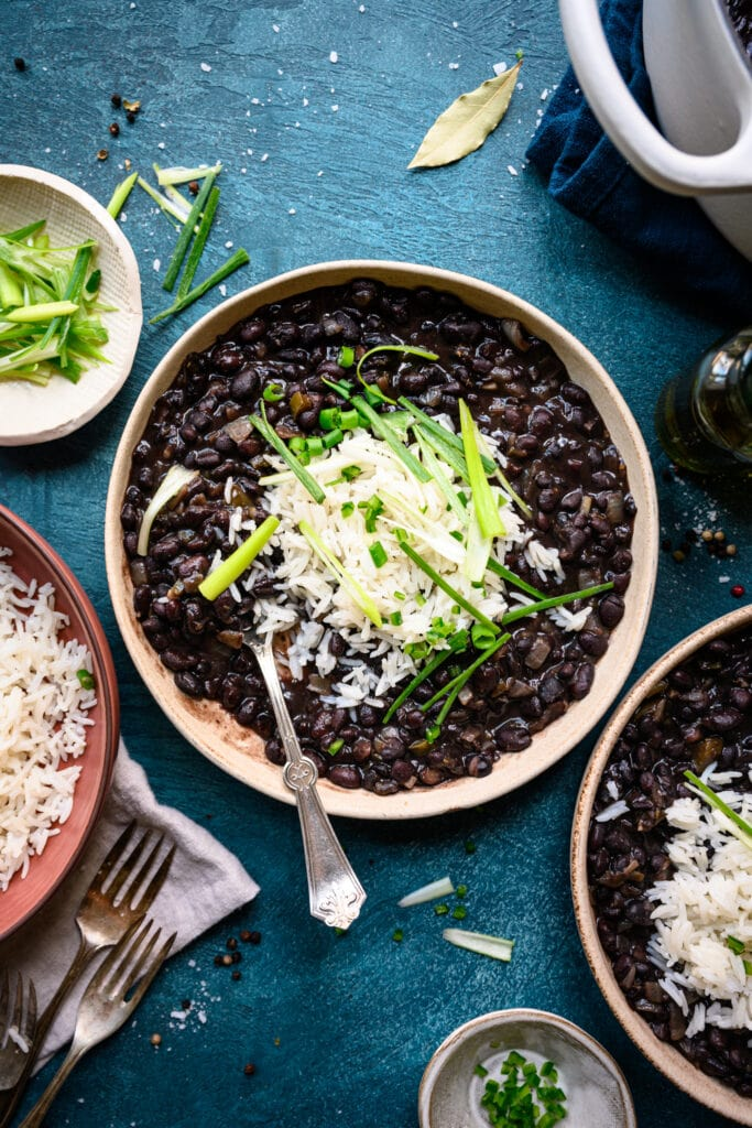 overhead view of vegan cuban black beans in bowls with rice