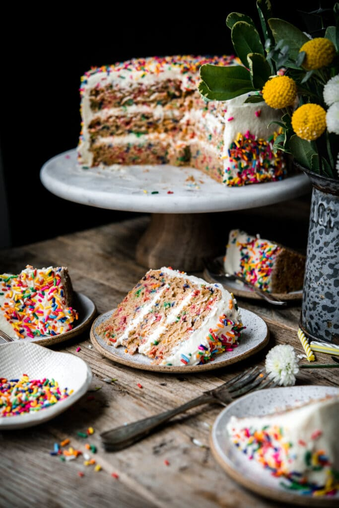 side view of slice of funfetti cake on small plates