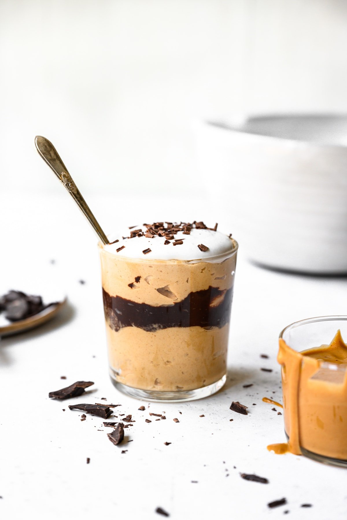 side view of vegan peanut butter chocolate mousse in a jar with spoon