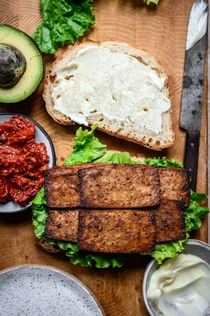 ingredients for vegan BLT sandwich with tofu bacon