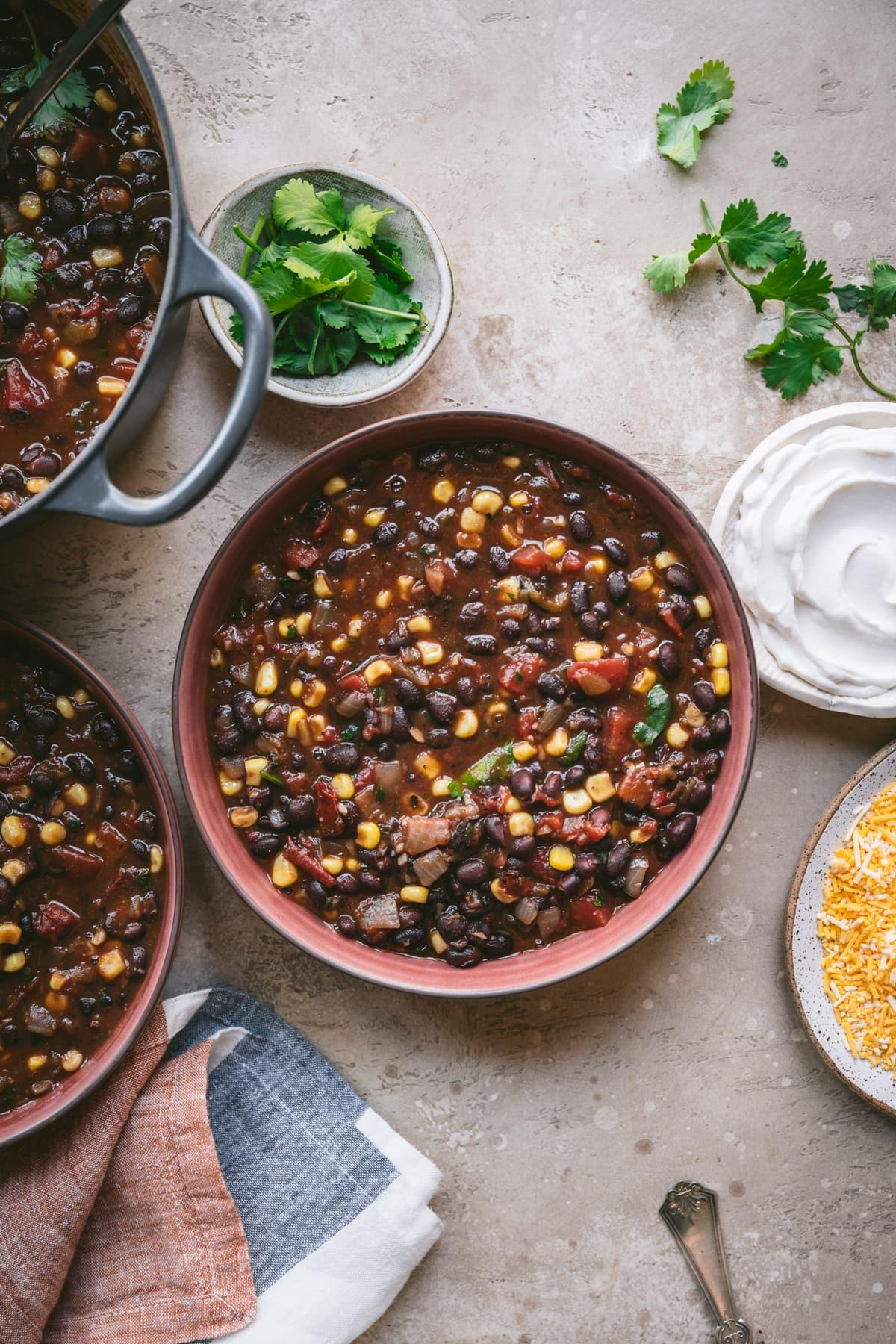 overhead view of vegan black bean tomato soup in bowl
