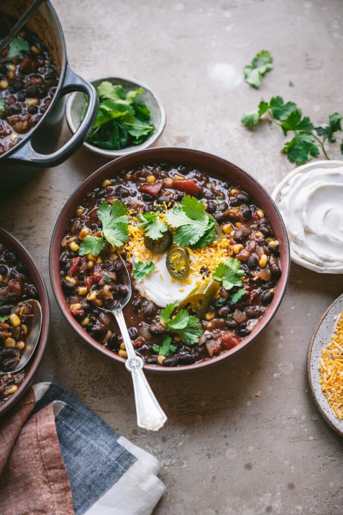 side view of vegan black bean soup in bowl
