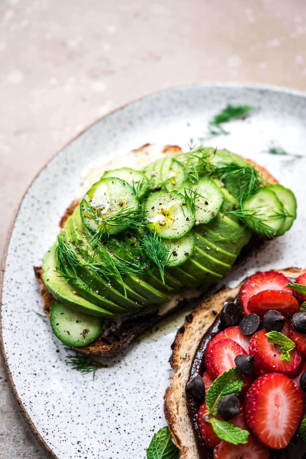 side view of tahini avocado toast on plate