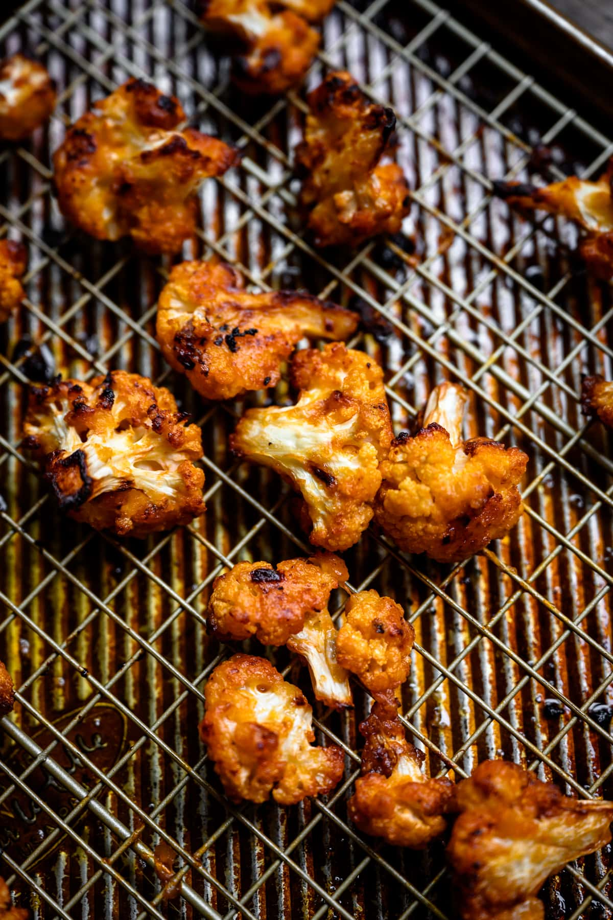 side view of roasted buffalo cauliflower on a sheet pan