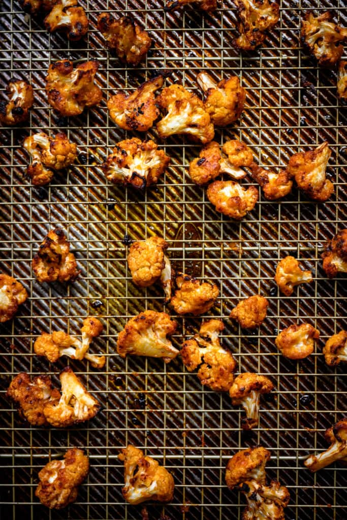 overhead view of roasted buffalo cauliflower on a sheet pan