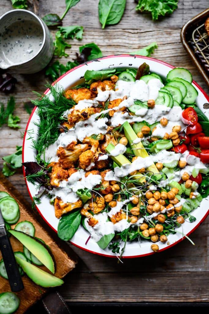 overhead view of vegan buffalo cauliflower salad with ranch