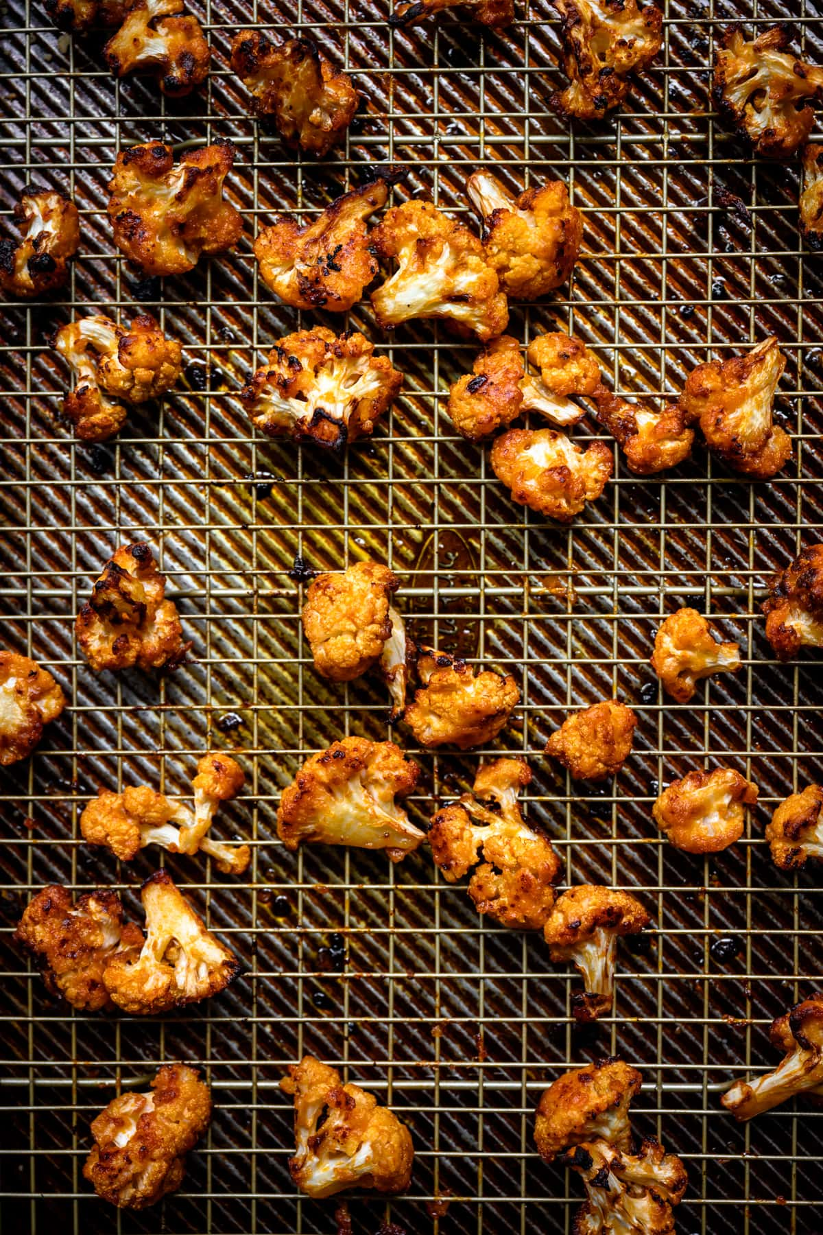 overhead view of roasted buffalo cauliflower on a sheet pan