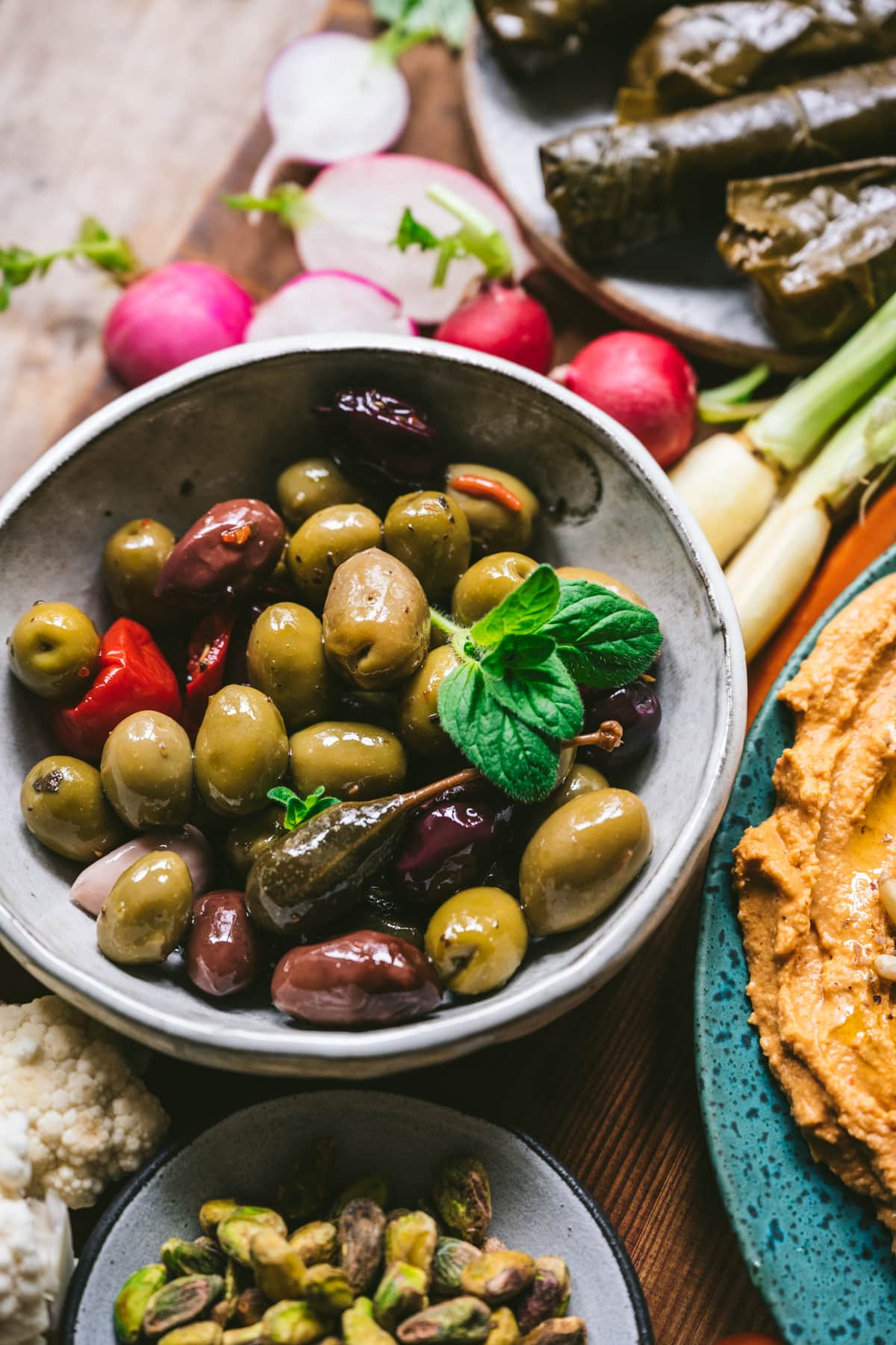close up view of marinated mixed olives on Mezze platter