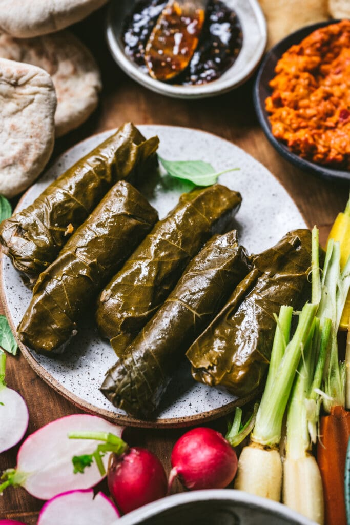 overhead view of grape leaves on plate