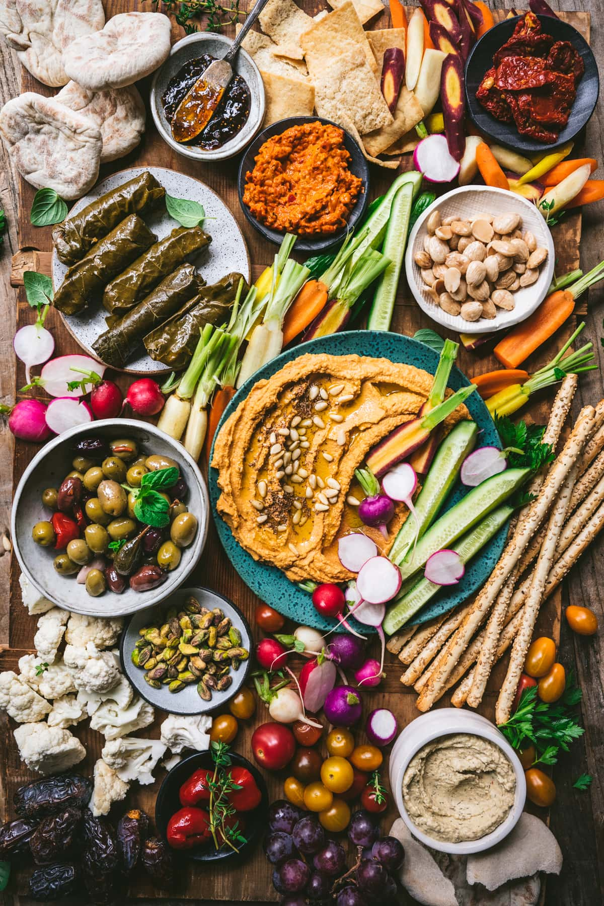 overhead view of Vegan Mezze Platter with hummus, dolma, nuts, vegetables and more