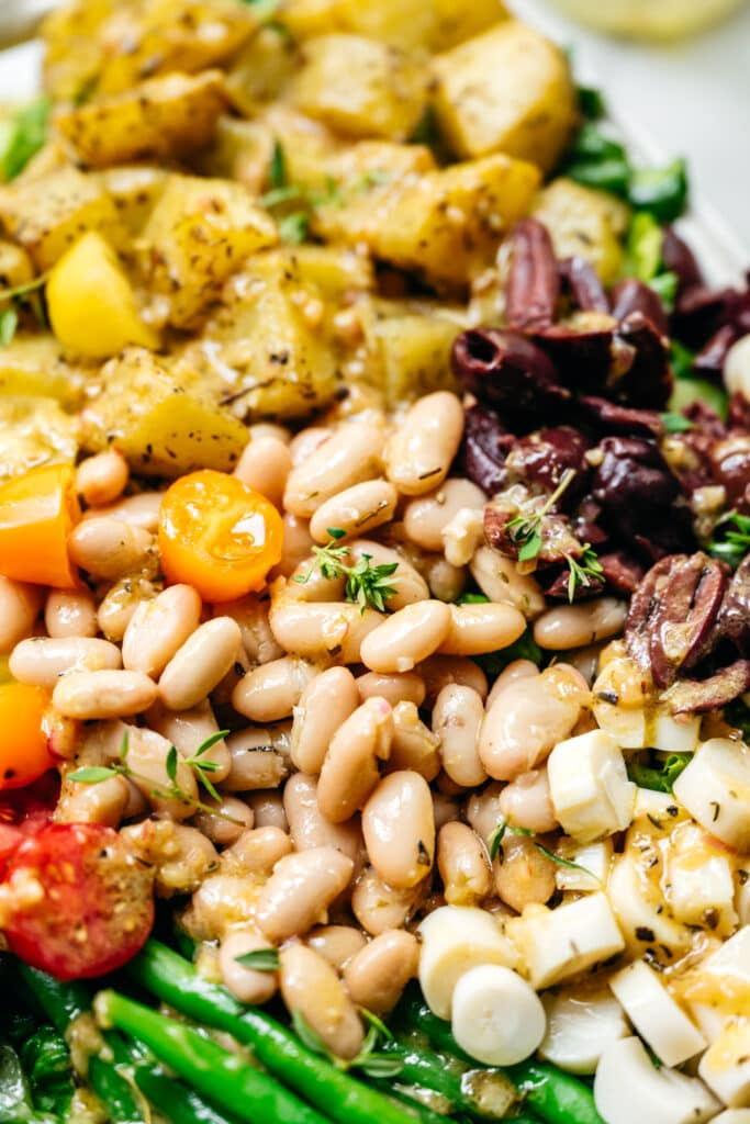 close up of white beans in a vegan nicoise salad