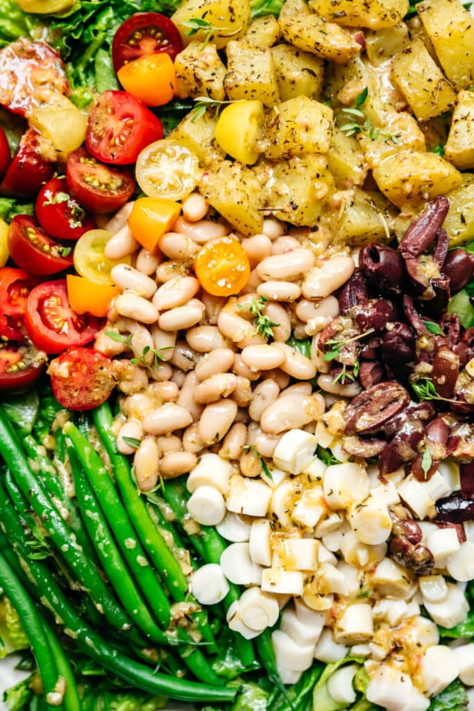 close up view of vegan nicoise salad with white beans and hearts of palm