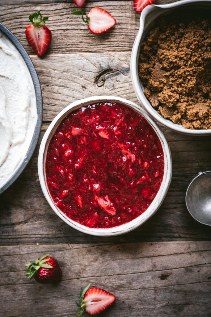 overhead view of strawberry jam filling for ice cream