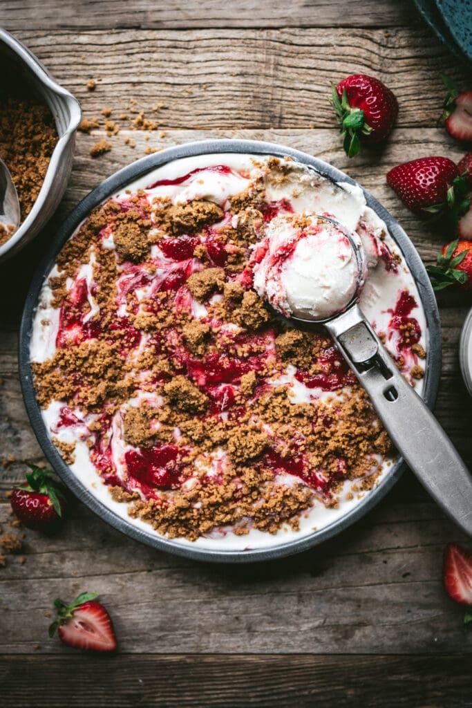 overhead view of vegan strawberry cheesecake ice cream in pan