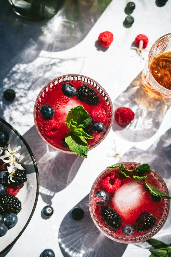 overhead view of berry bourbon cocktail