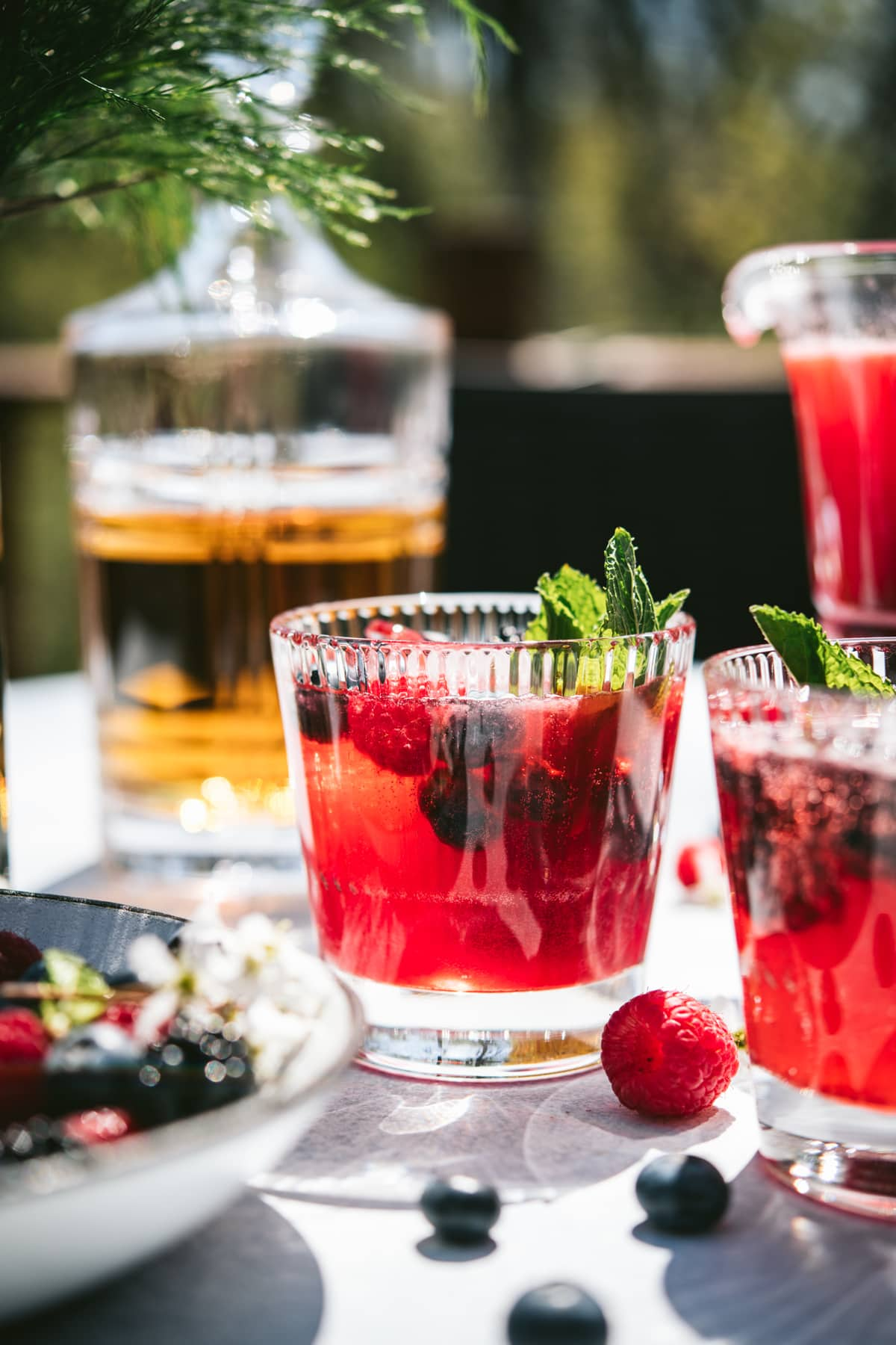 side view of berry bourbon lemonade cocktail