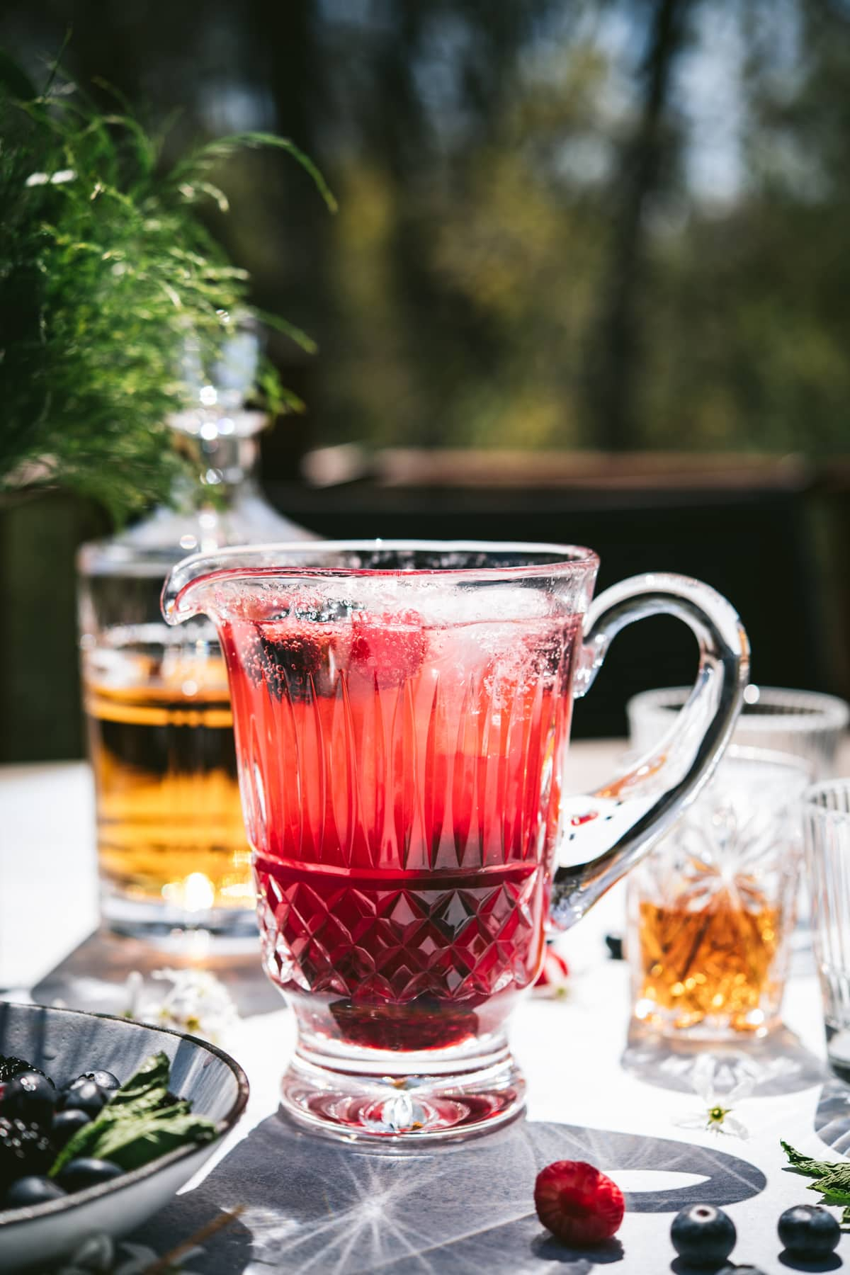 side view of summer bourbon berry pitcher cocktail