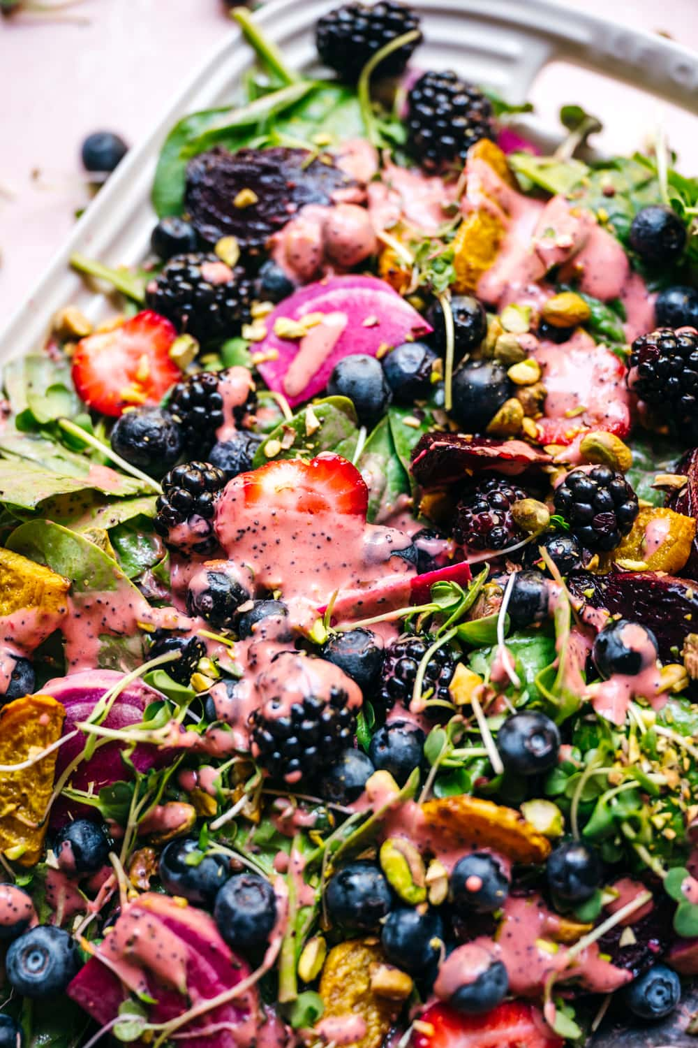 close up view of roasted beet berry salad with strawberry poppy seed dressing