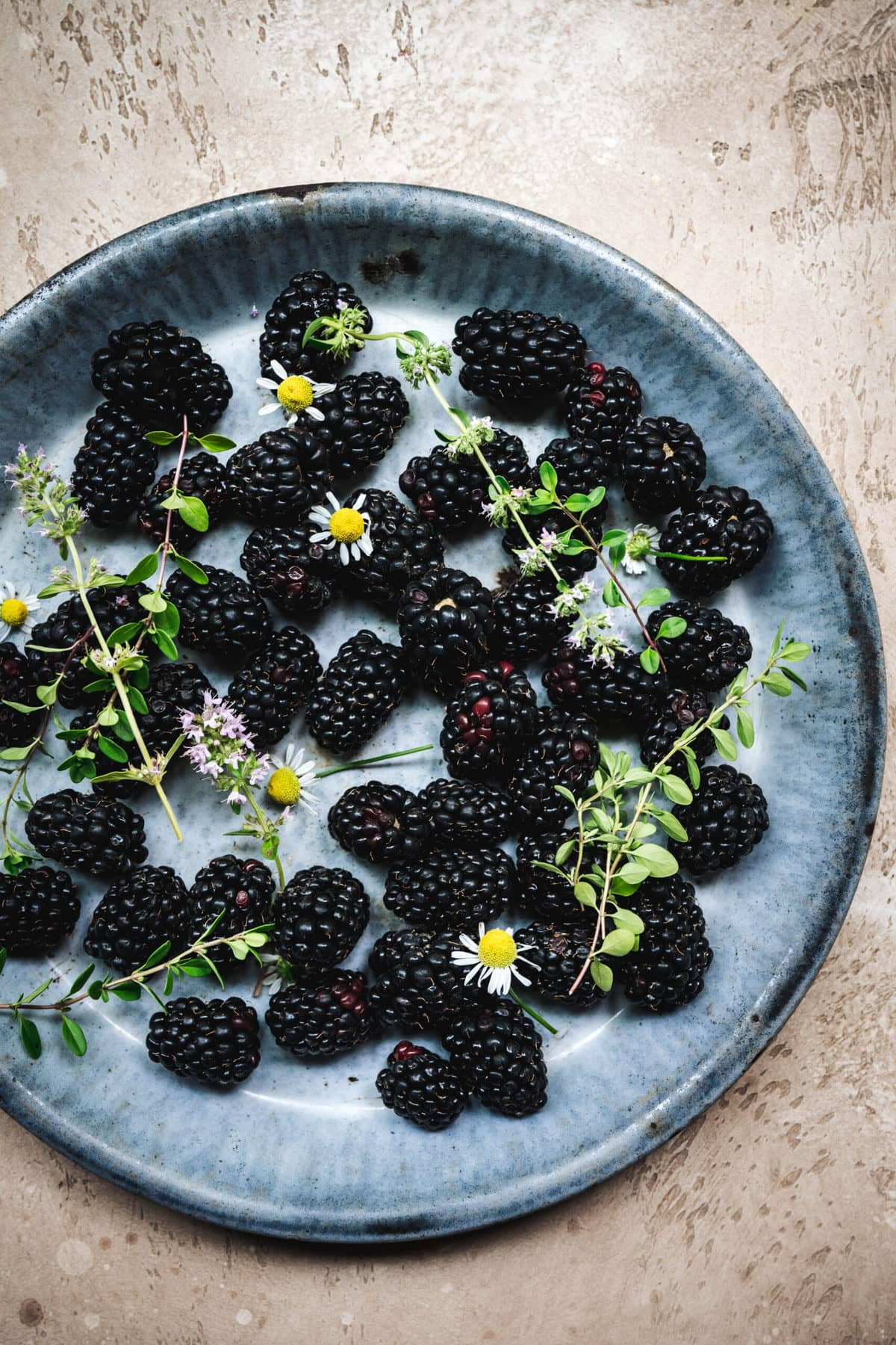 overhead view of blackberries in a shallow bowl