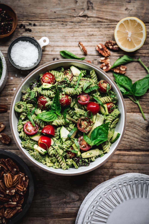 overhead view of pesto pasta salad in bowl