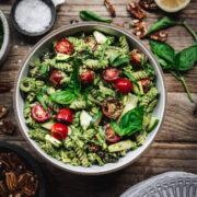 overhead view of pecan pesto salad in bowl