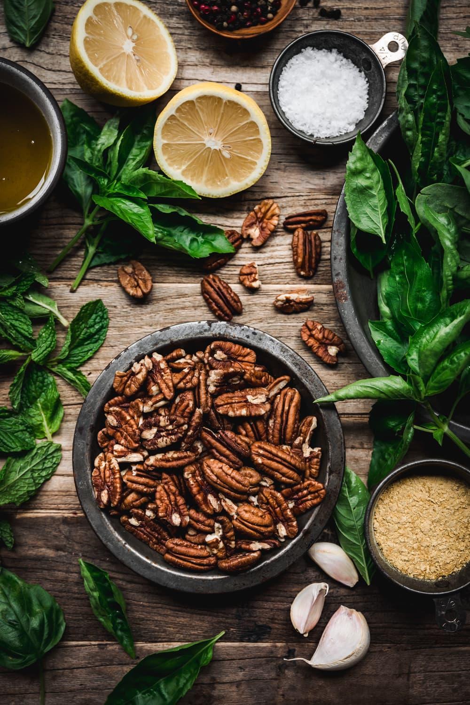 overhead view of ingredients for pecan pesto
