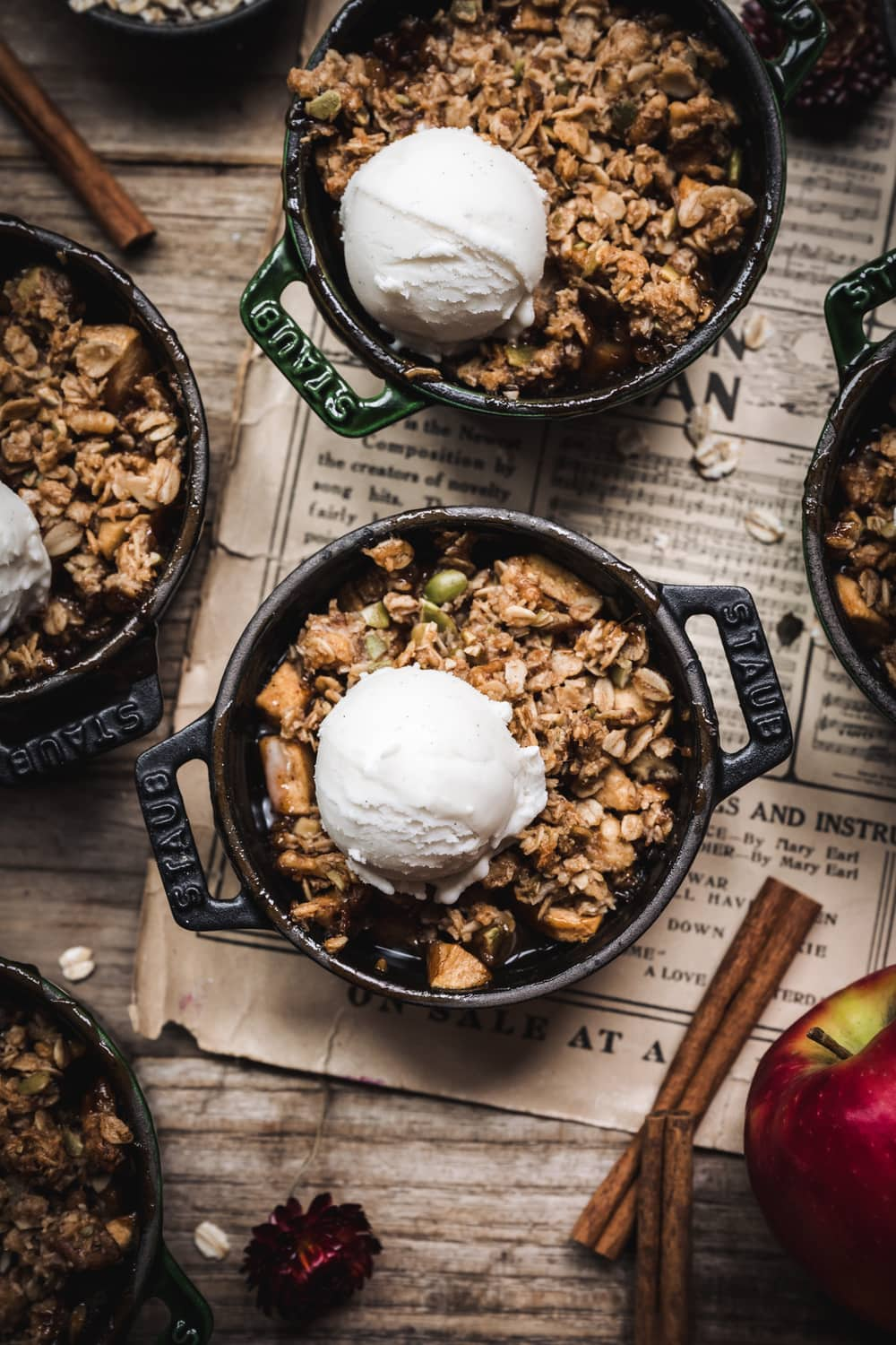 overhead view of apple crisp in ramekin with vanilla ice cream