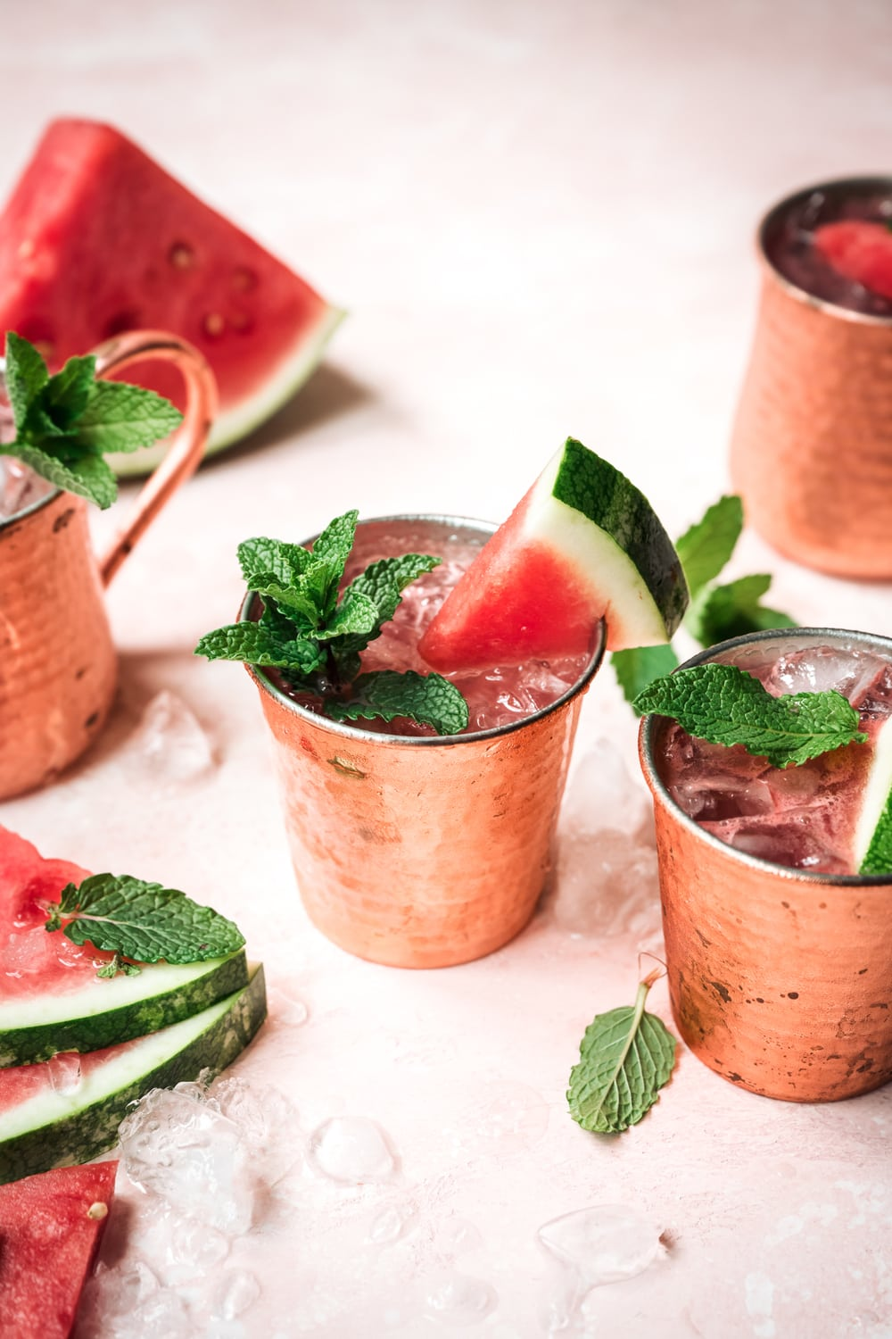 side view of watermelon moscow mule in copper mug with mint garnish