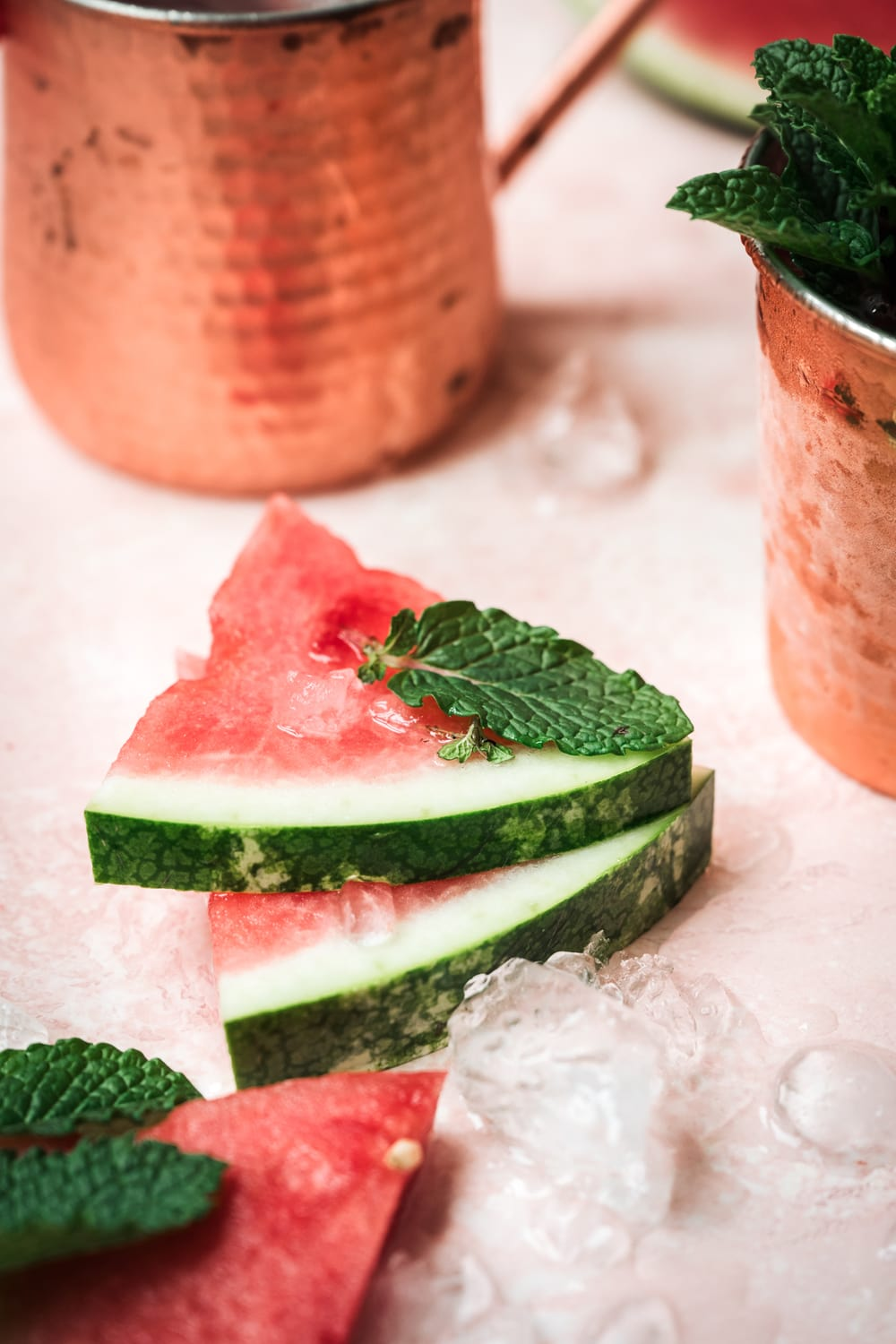 watermelon and mint on pink backdrop