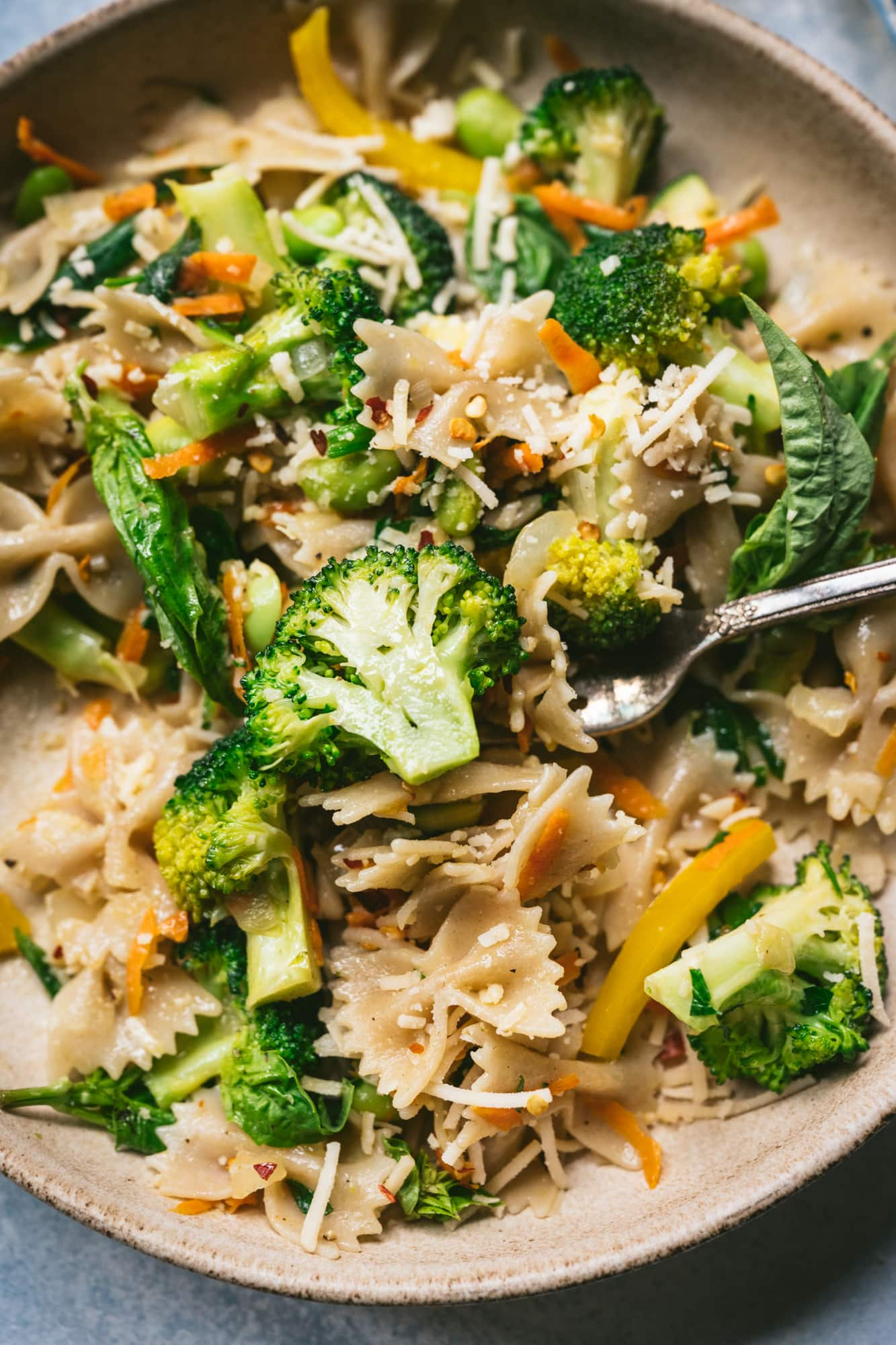 overhead view of vegan pasta primavera in a bowl with fork