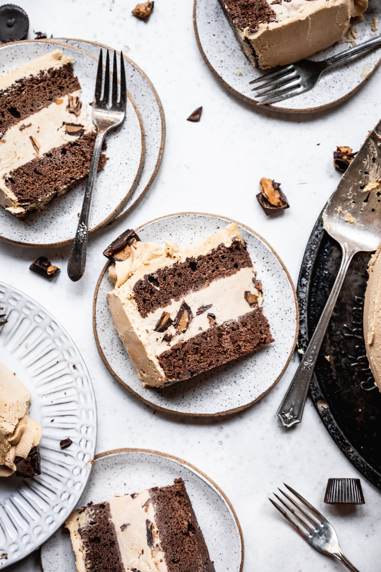 overhead view of chocolate peanut butter ice cream cake slices on white plates